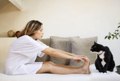 getty_rm_photo_of_woman_stretching_with_cat