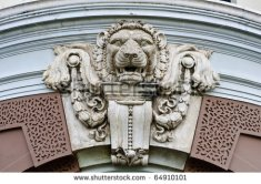 stock-photo-lion-head-detail-of-antique-sculpture-from-grand-palace-thailand-64910101